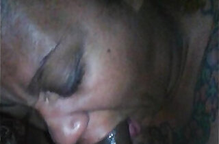 Cum oozes out of her mouth as she sucks my dick
