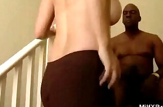Horny interracial lovers get freaky on the stairs