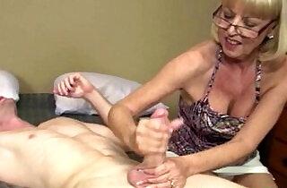 Mature tugging granny getting cum blasted