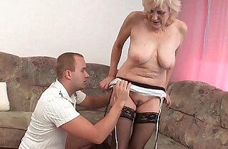 Grandma in stockings gets huge facial